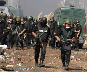 Egypt's security forces breaking up a protest in the Nasr City district of Cairo