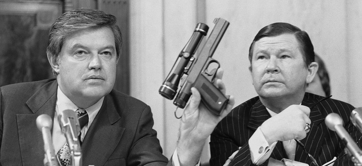 Sen. Frank Church D-Idaho, holding a CIA dart gun at a committee hearing