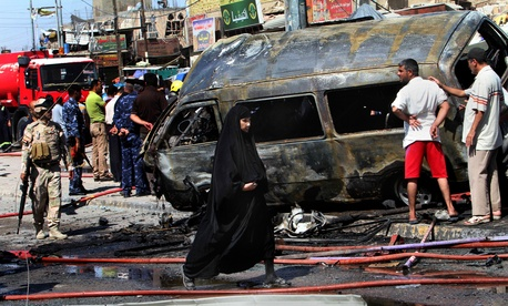 In Basra sits the wreckage from one of more than a dozen coordinated car bombs insurgents exploded across Iraq on Monday, July 29, 2013.