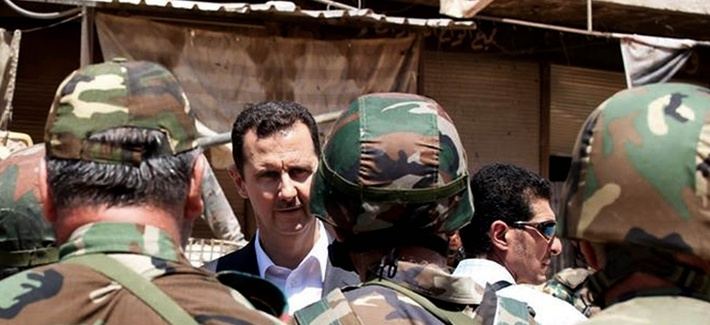 Syria's President Bashar Assad speaks to his troops in Darya, Syria.