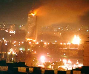A building on fire after a NATO bombing run in the former Yugoslavia