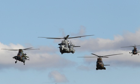 French military helicopters showing off the weapons used to fight former Libyan dictator Muammar Qaddafi