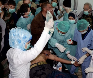 Doctors treat a victim of an a possible chemical attack at a village in Syria