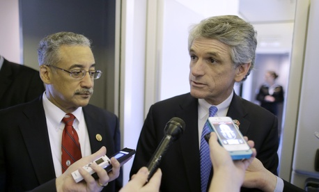 Reps. Bobby Scott, D-Va. and Scott Rigell R-Va. speak to reporters in Newport News, Va.