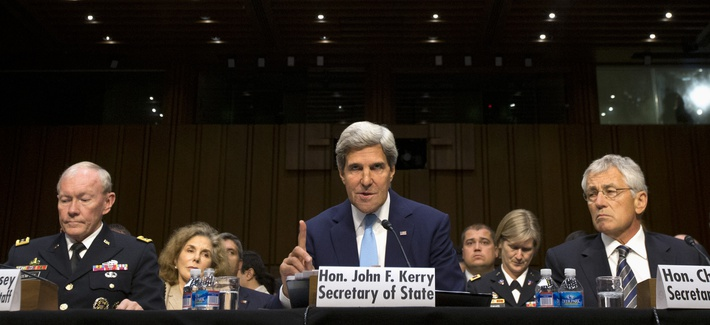 Secretary of State John Kerry, Secretary of Defense Chuck Hagel, and Chairman of the Joint Chiefs of Staff Martin Dempsey at a Senate Foreign Relations Committee hearing