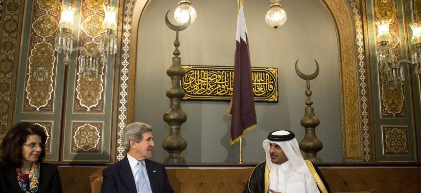 Qatar's leader Sheik Tamim bin Hamad Al Thani speaking with Secretary of State John Kerry