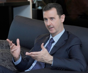 Syria's President Bashar Al-Assad speaks to a Russian reporter in late August