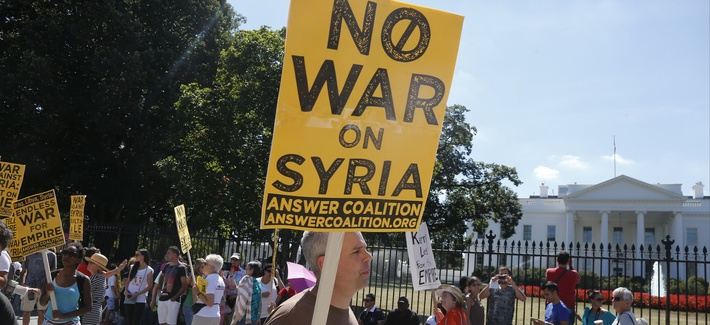 An anti-war protestor stands outside the White House