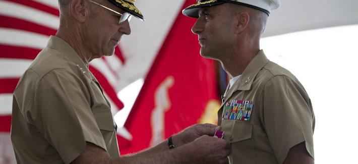 Lt. Gen. Duane Thiessen, commander of U.S. Marine Corps Forces, Pacific, pins the Legion of Merit onto Col. Steve Manning, who retired after a 32-year career, in a ceremony aboard the U.S.S. Missouri Memorial, Ford Island, HI, Feb. 28, 2012.