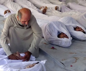 A man mourns the victims of an alleged chemical weapons attack in Syria