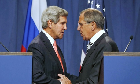 Secretary of State John Kerry and Russia's Foreign Minister Sergei Lavrov after coming to an agreement on a chemical weapons deal for Syria