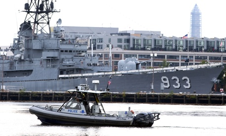 A police boat patrols the water near Washington Navy Yard