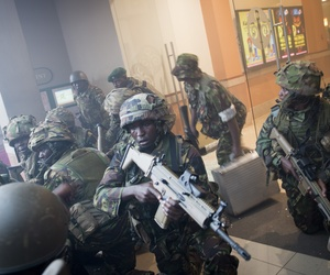 Armed police respond to the attack on the Westgate Mall in Nairobi, Kenya on Saturday.