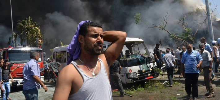 A man reacts after a car bomb attack in Tripoli, Lebanon
