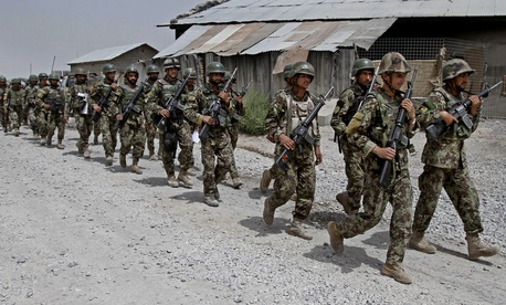 Afghan National Army soldiers marching in a district in Kandahar