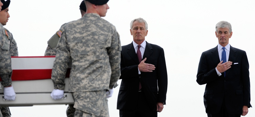 Defense Secretary Chuck Hagel and Army Secretary John McHugh at Dover AFB on Wednesday for the homecoming of four soldiers killed in Afghanistan this weekend.