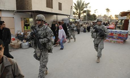 U.S. soldiers patrol a market in Baghdad in 2009.