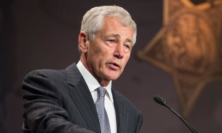 Officials are urging Defense Secretary Chuck Hagel to divide power of Cyber Command and NSA operations.