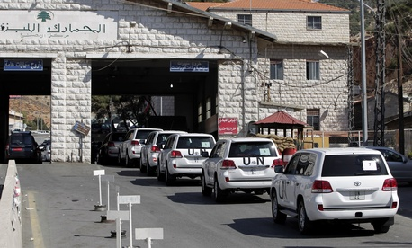Inspectors from the OPCW at a border crossing between Lebanon and Syria