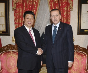 Then Chinese Vice President, and current President Xi Jinping, left, shakes hands with Turkey's Prime Minister Recep Tayyip Erdogan in Istanbul, Turkey, Feb. 21, 2012.