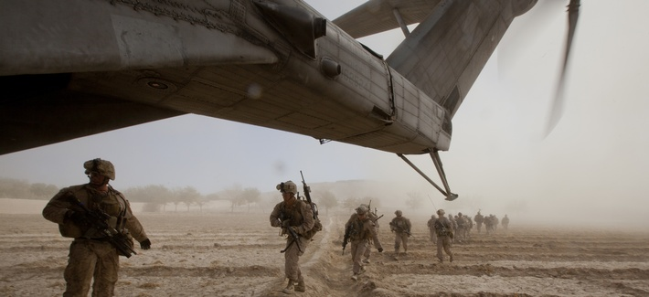 In Gurjat, Helmand province, Afghanistan, U.S. Marines with Bravo Company, 1st Battalion, 9th Marine Regiment run toward a CH-53E Super Stallion, Oct. 28, 2013.