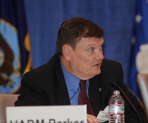 Navy CIO Terry Halvorsen speaking during a panel on cyber warfare