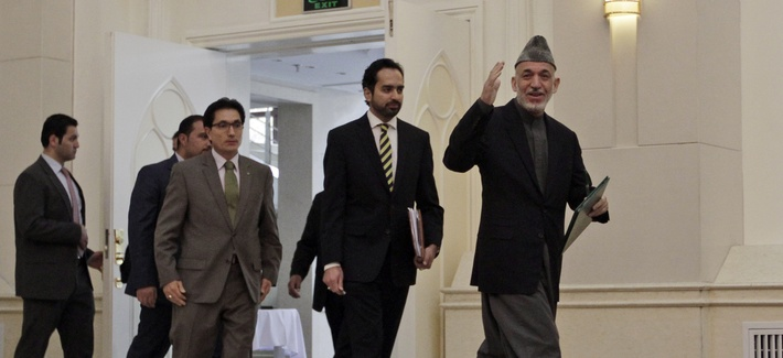 Afghan President Hamid Karzai heads to a press conference on Nov. 16