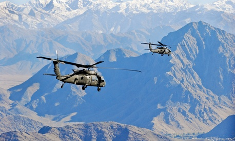 Two Army Black Hawk helicopters fly over Logar province in Afghanistan earlier this month