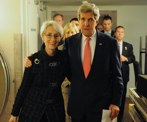 Secretary of State John Kerry with Under Secretary of State for Political Affairs Wendy Sherman after the P5+1 reached a nuclear deal with Iran in Geneva, Switzerland, Nov. 24, 2013.