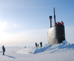 Sailors from the USS Annapolis walking around after it surfaced in the Arctic Ocean