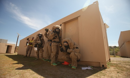 Chemical, biological, radiological and nuclear defense Marines with Headquarters Company, Combat Logistics Regiment 17, 1st Marine Logistics Group, train during a hazardous material course at Camp Pendleton, Calif., March 2013.