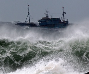 A boat is thrashed by waves near Jeju Island, which is near Sokora Island