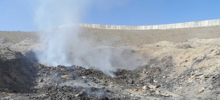 One of the open-air burn pits used by troops at FOB Sharana