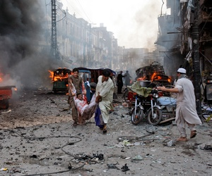 Men carry out victims from a car bomb attack in Peshawar, Pakistan