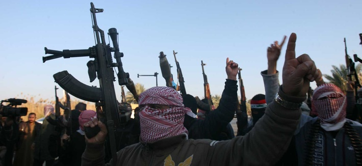 Gunmen in Fallujah, Iraq, chant slogans against the Iraqi government
