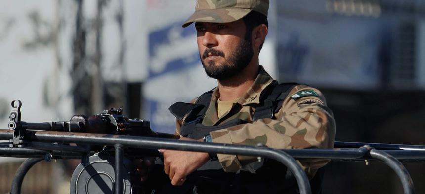 A Pakistani soldier stands guard during a curfew in Rawalpindi, Pakistan