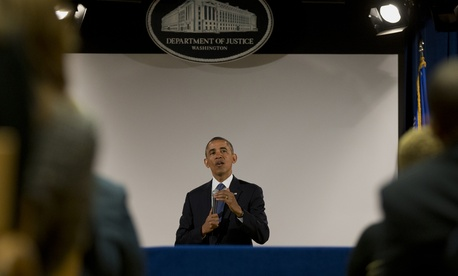 Following his NSA speech, President Barack Obama spoke to an overflow room at the Department of Justice, Friday, Jan. 17, 2014.