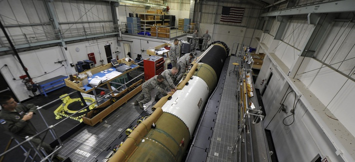 Airmen working on a Minuteman III ICBM at Vandenberg Air Force Base, Calif.