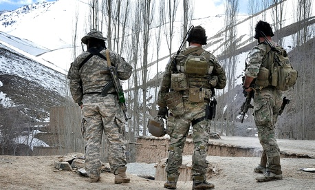 A group of Special Forces scan a valley in the Uruzgan province, Afghanistan. The number of special forces is set to increase in the Pentagon's proposed budget