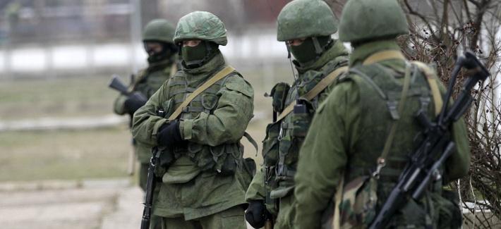 Unidentified gunmen guard Ukraine's infantry base in Privolnoye, Ukraine, on Sunday.