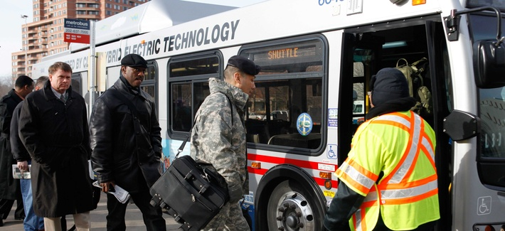 Pentagon employees board a bus near the Pentagon metro station