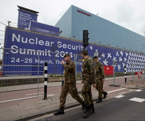 Soldiers patrol the outside of the World Forum congress center, where the 2014 Nuclear Security Summit will be held