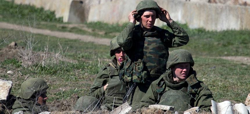Pro-Russian troops standing in position in Feodosia, Crimea.
