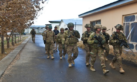 U.S. soldiers from the 3rd Brigade Combat Team, 10th Mountain Division head to a meeting about the upcoming presidential election at Forward Operating Base Rushmore in Paktika province last week.