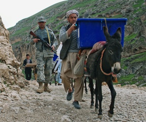 Afghan election workers carry ballot boxes to polling stations in Mazar-i-Sharif