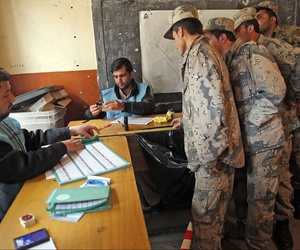 Afghan security forces cast their votes at a polling station in Kabul, Afghanistan, Saturday, April 5, 2014.