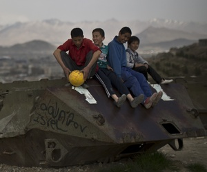 Afghan youths overlooking Kabul on Tuesday, April 1, 2014.