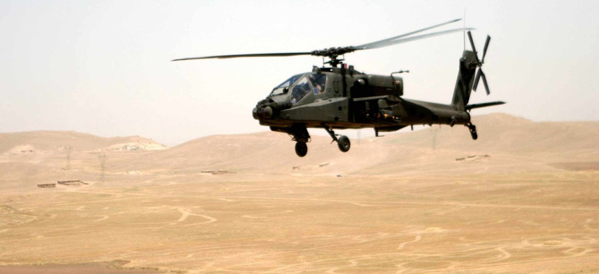 An Apache attack helicopter flies a route between Tall'Afar and Mosul, Iraq, in June 2006.