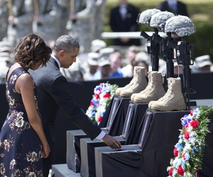 President Barack Obama and First Lady Michelle Obama pay their respects during a memorial ceremony at Fort Hood on Wednesday.