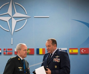At right, NATO's Supreme Allied Commander for Europe, Gen. Philip Breedlove, speaks with Chairman of the NATO Military Committee, General Knud Bartels, during a meeting of NATO defense ministers in June 2013.